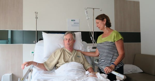 Jack Pearce with his wife in the hospital
