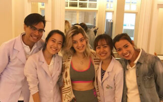 Lorena with staff undergoing ataxia stem cell treatment in Thailand
