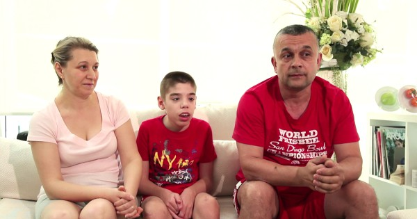 Alexandru Spiridon and parents on couch discussing their Stem Cell treatment