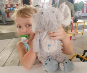 Lotta with her plush elephant