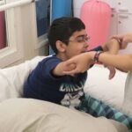 Saif during a physiotherapy session